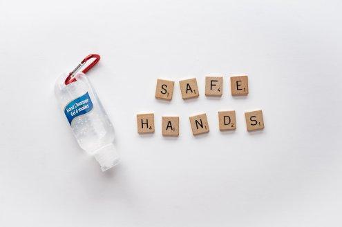 hand-sanitizer-and-letter-tiles-spelling-safe-hands